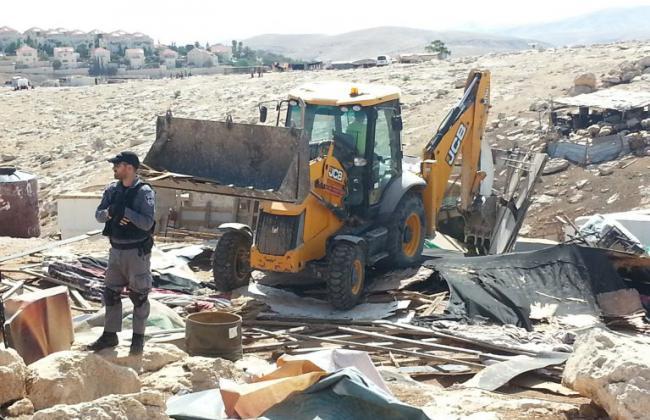 JCB vehicle demolishing buildings